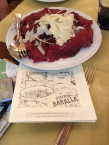 Chianina beef carpaccio with slices of Grana (cheese).   Heaven on a fork!