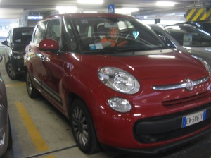 "A Fiat 500 L. . . And our first thought was, "" this is a large car for small streets.  Glad we got bumper to bumpers no fault insurance!"""