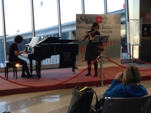 Flute and piano duo in our departure lounge. . Milan